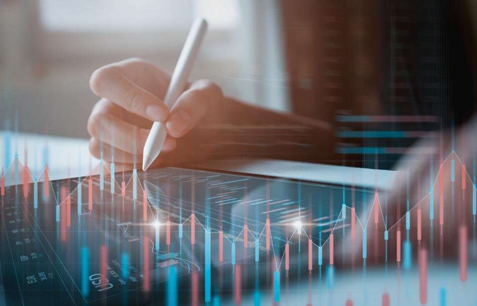 Businessman trader looking on tablet with graphs analysis candle line