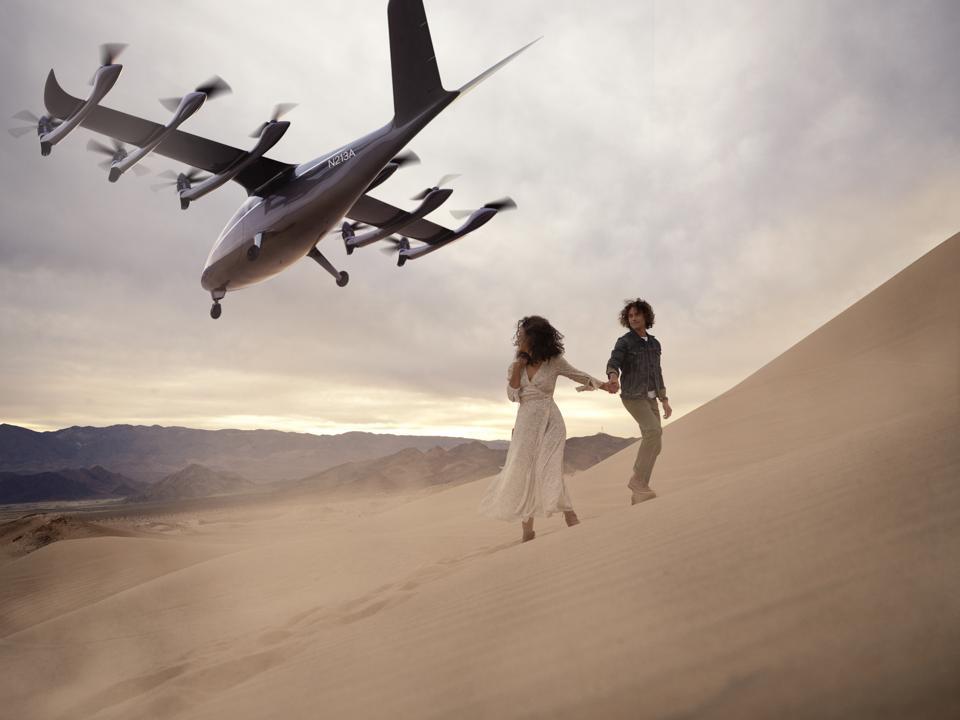 Archer's zero-emissions aircraft flies over a desert landscape.