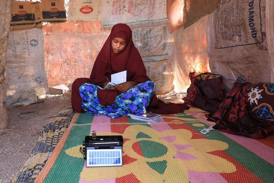 Students in Ethiopia listen to radio lessons from home.