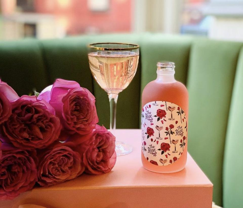 a bouquet of roses and a pink valentine's cocktail from dante west village