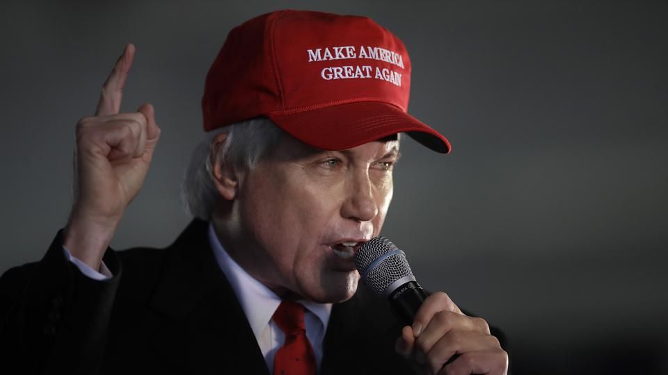 Lin Wood wearing Trump MAGA hat