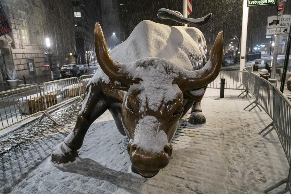 A major snowstorm hits New York City and leaves a good bit of snow along Wall Street.