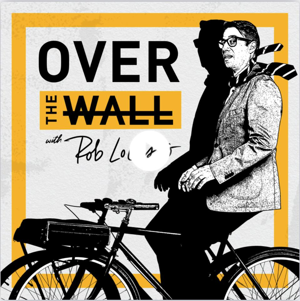 promo image with business man riding bicycle in front of words saying Over the Wall