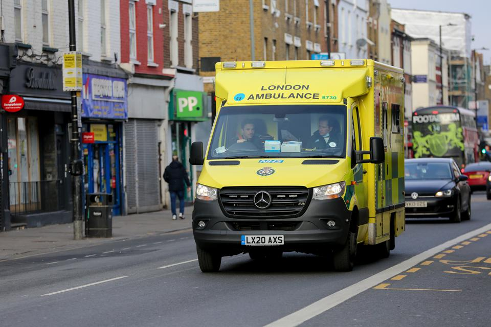 A London ambulance is seen on the street.  The London...