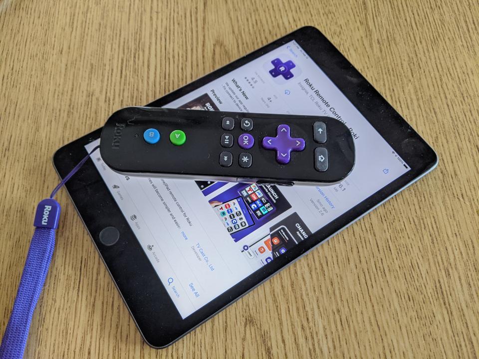 Photo of an iPad showing the suspect ″Roki″ Roku remote-control app, below a Roku remote.