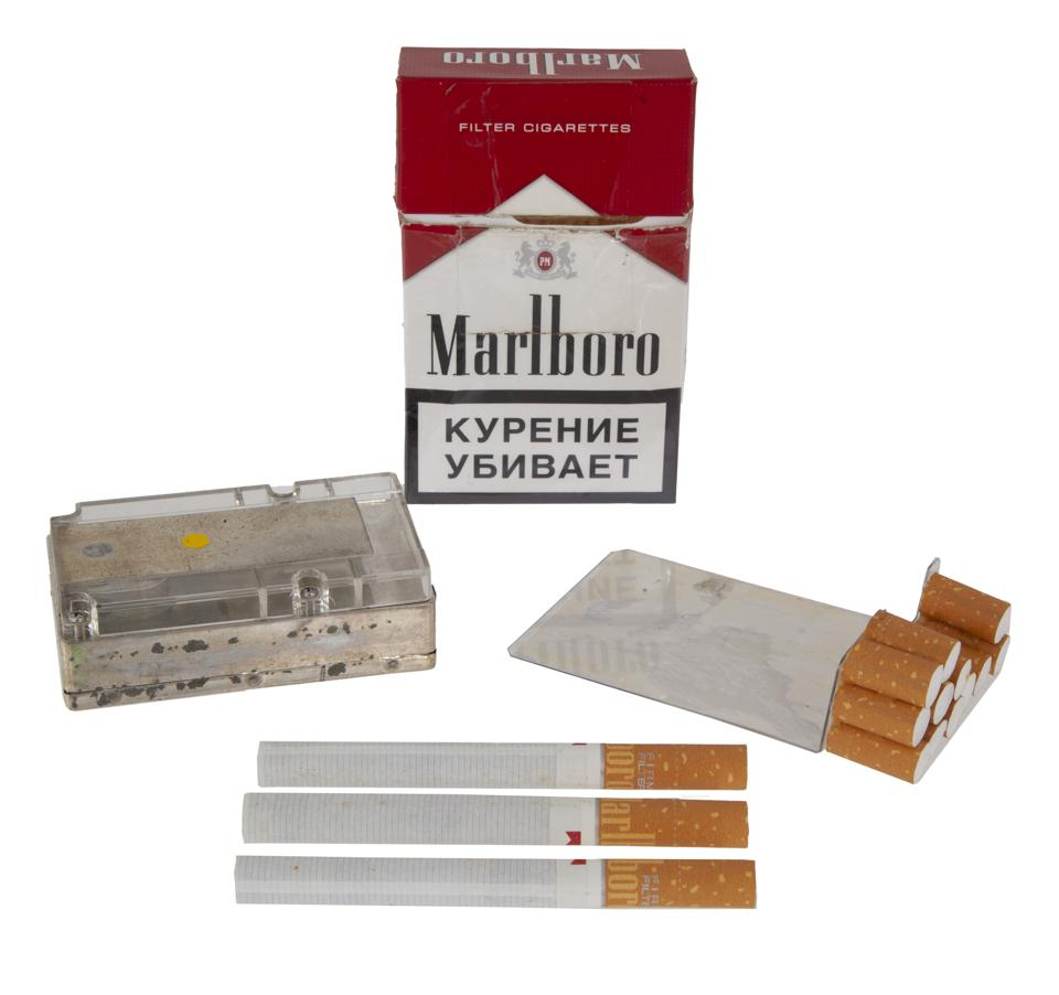 A pack of Marlboro cigarettes fitted with an internal digital camera that has been covered by the filters of the cigarettes.