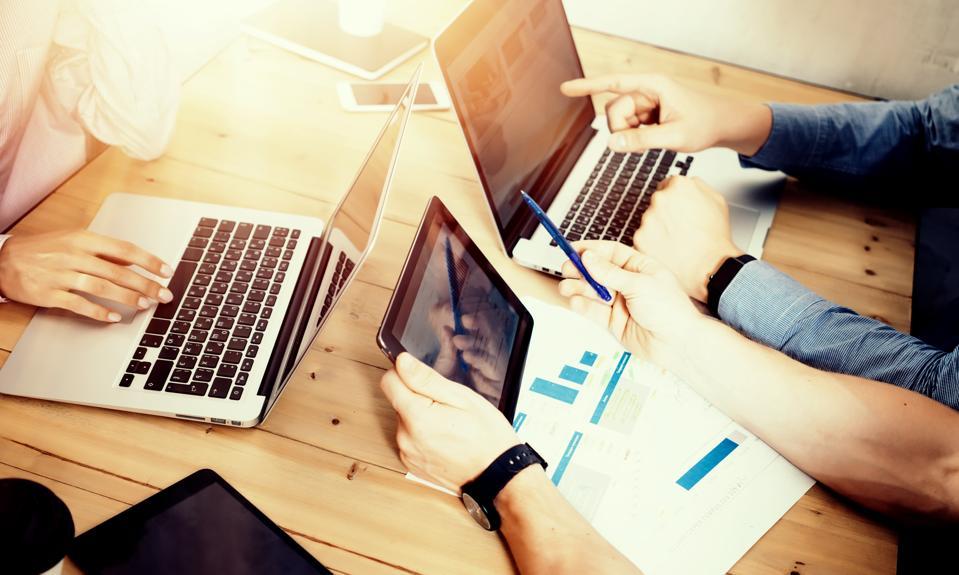 Work team brainstorming business strategy.
