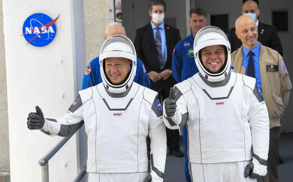 NASA commercial crew astronauts Doug Hurley and Bob Behnken leave for their flight aboard the SpaceX Falcon 9 rocket bound for the International Space Station.