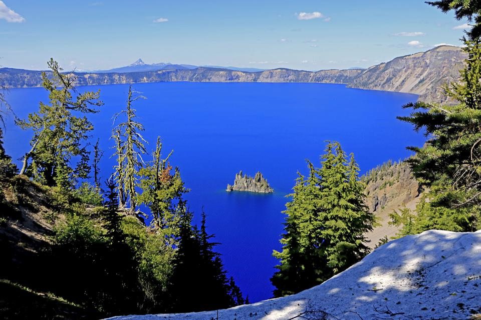 The water in the Phantom Ship rock in Crater Lake National Park Oregon is impossibly blue