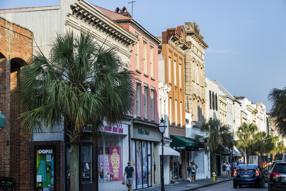 There are colorful buildings on the historic King Street in Charleson South Carolina