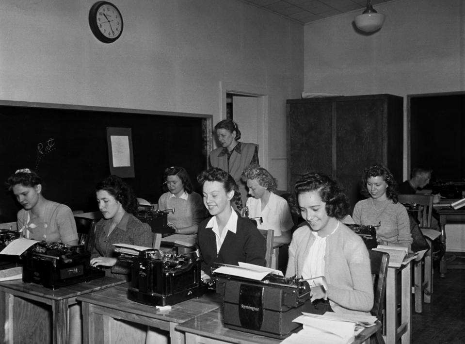 Young Women in Secretarial Pool Typing Documents