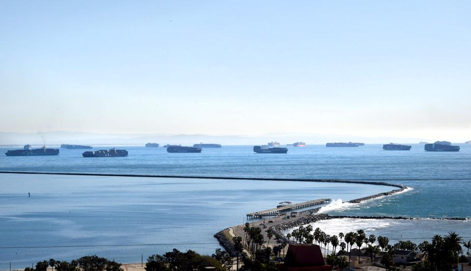 Container ships queue outside Los Angeles and Long Beach.