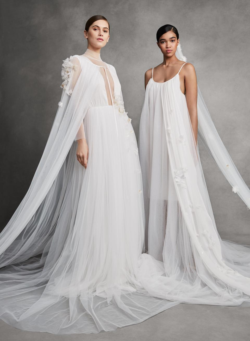two models in white bridal gowns designed by Parsons School of Design graduate Andrew Kwon