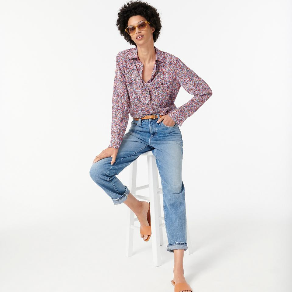 Woman sitting on a stool wearing a J. Crew floral shirt