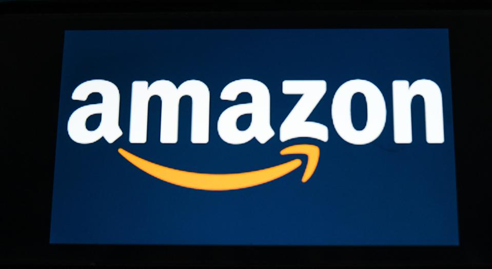 In this photo illustration an Amazon logo seen displayed on...