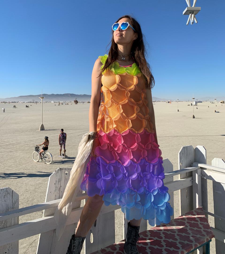 DressX co-founder Natalia Modenova wearing a rainbow Paskal dress in the desert.