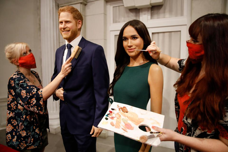 Artists put the finishing touches on wax figures of Britain's Prince Harry and Markle.