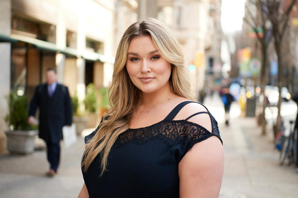 Hunter McGrady stands in the street.