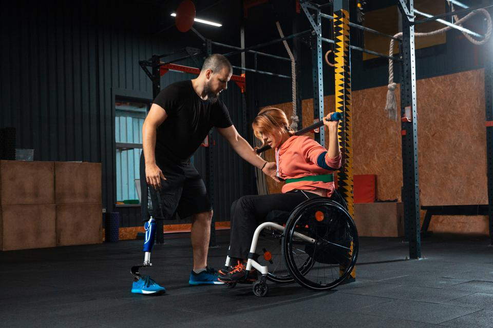 Disabled woman training in the gym of rehabilitation center