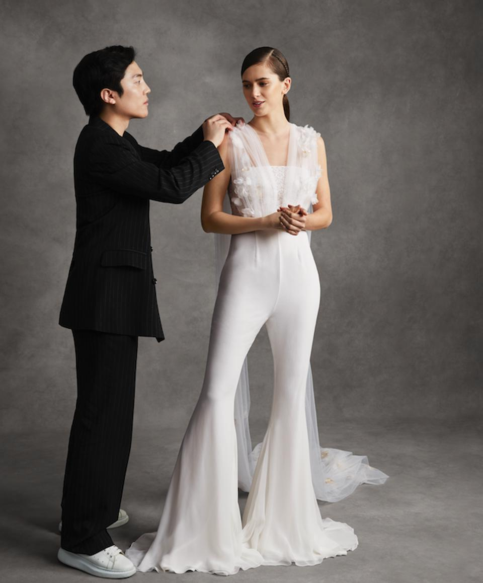 Andrew Kwon with a model wearing his bridal pantsuit design