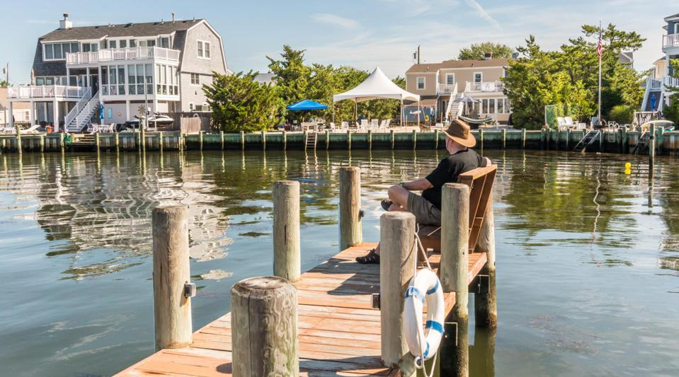 A man sitting on a dock during the summer in Nantucket.