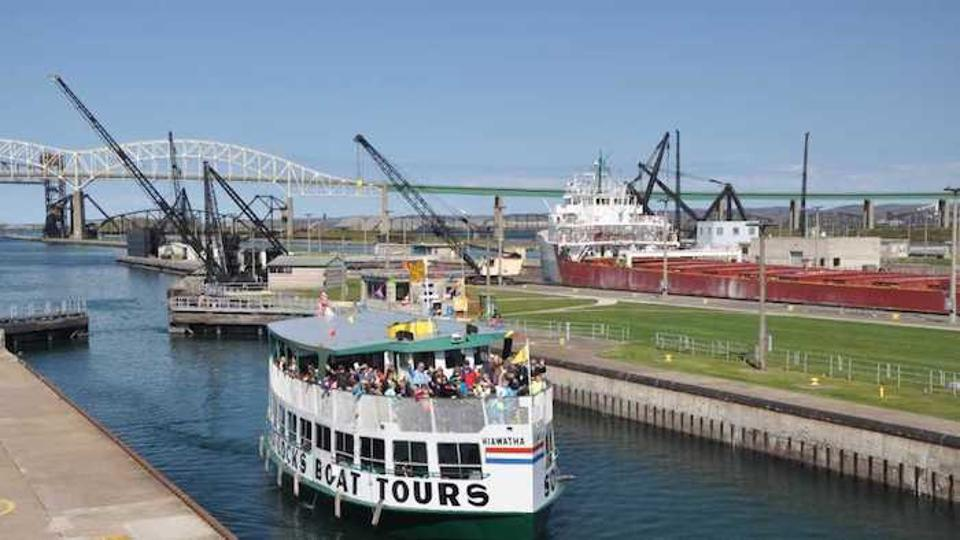 A Soo Locks Boat Tour with people in the Upper Peninsula.