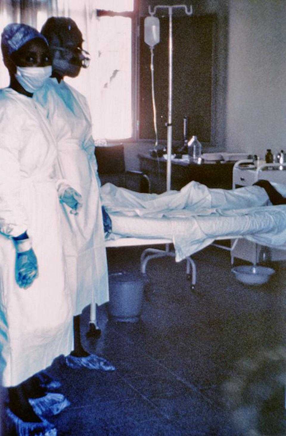 Two nurses with an Ebola patient during the 1976 outbreak of Ebola in Zaire.
