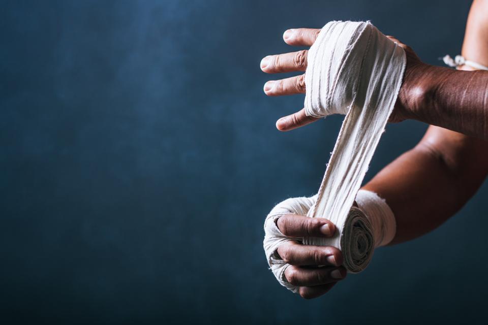 Cropped Image Of Man Typing Bandage On Hand
