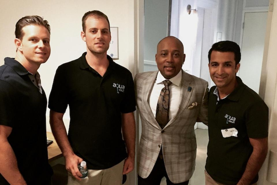 Three AquaVault principals with Daymond John