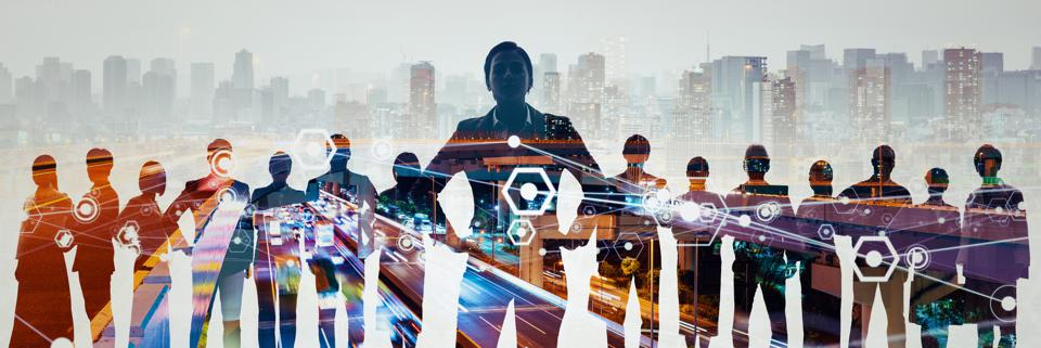 A network of business leaders look towards the future with a city in the background