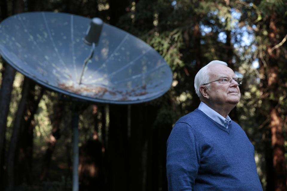 Dr. Frank Drake, the founder of SETI, at his home in 2015, with a radio dish.