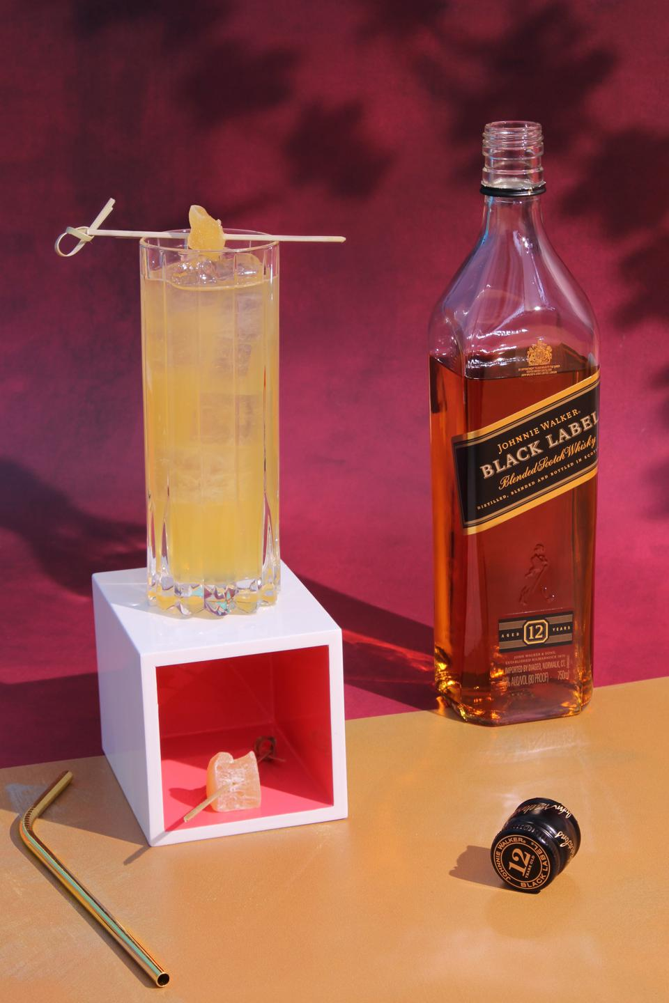 Gold Moon Highball with bottle of Johnnie Walker Black