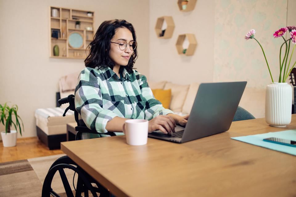Young businesswoman with physical disability working online from home