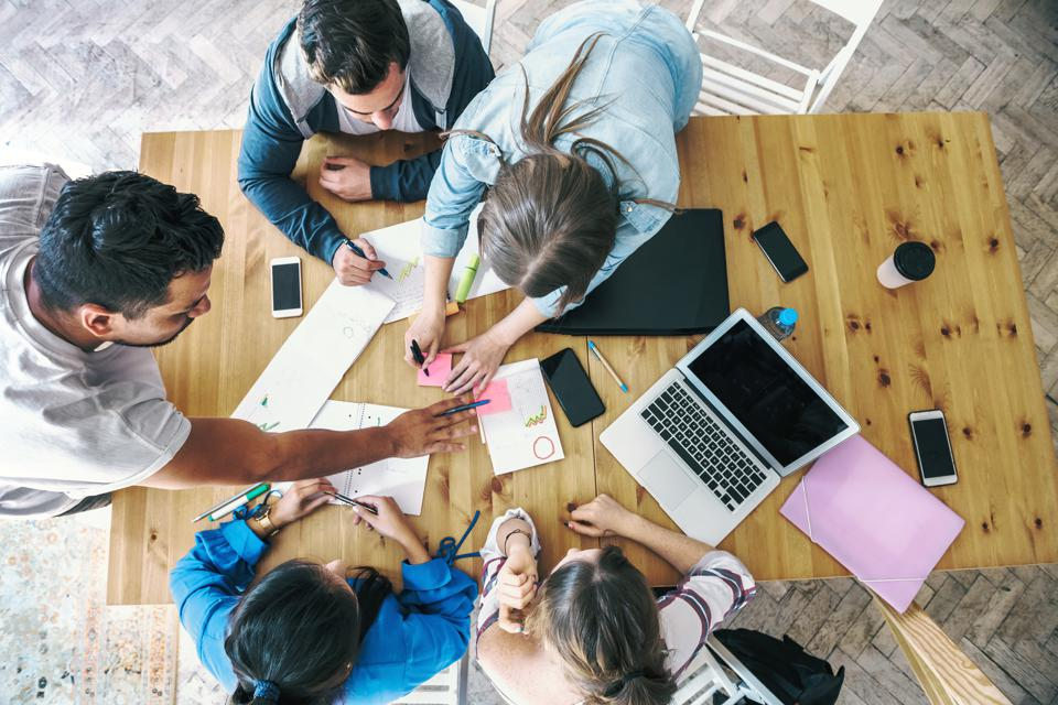 overhead view on business people working together on desk