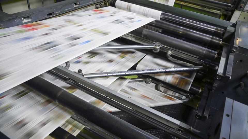 Newspaper printing press in a printing plant