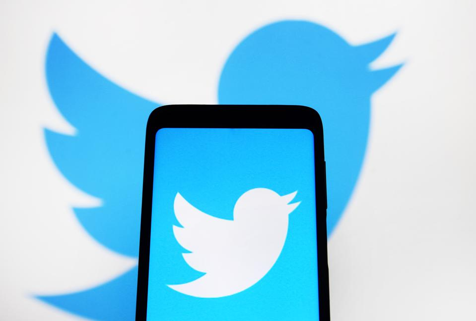 Photo of a phone with the Twitter logo.