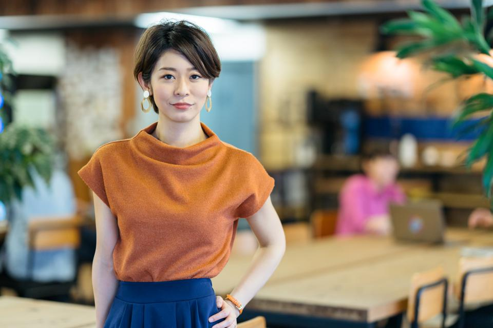 Portrait of young business woman in modenr co-working space
