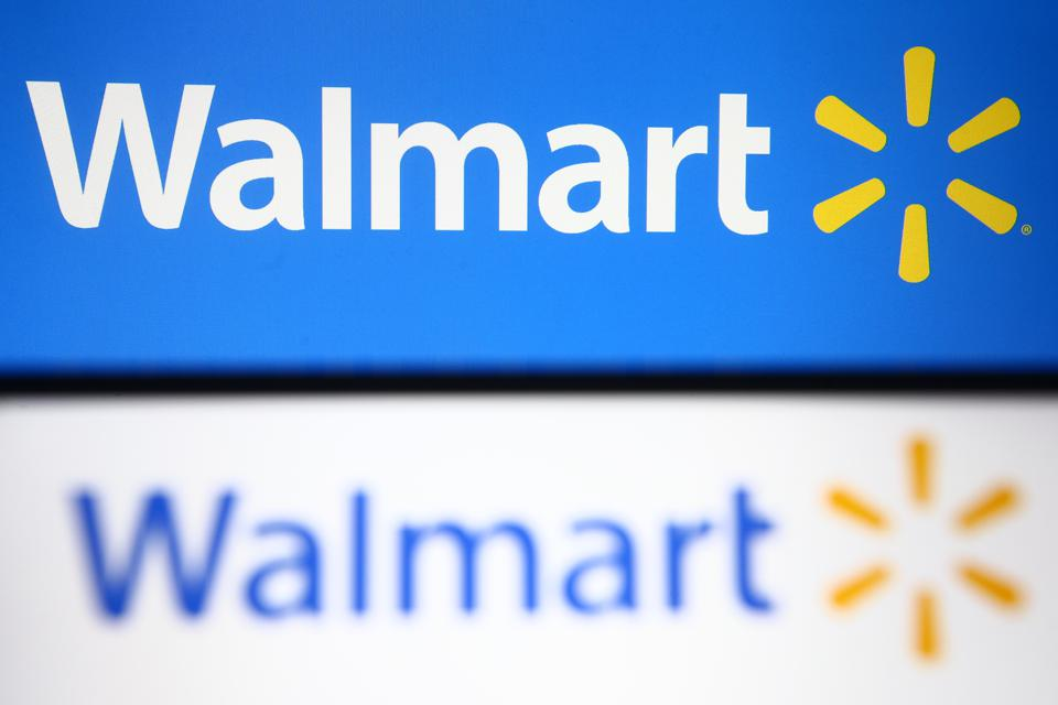 In this photo illustration, Walmart logo is seen displayed...