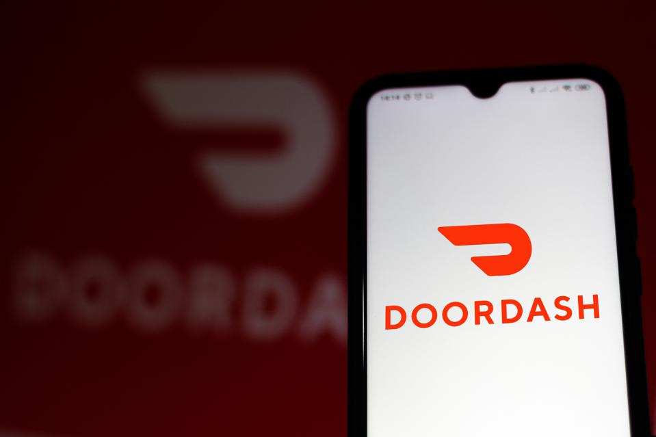 In this photo illustration the DoorDash logo seen displayed...