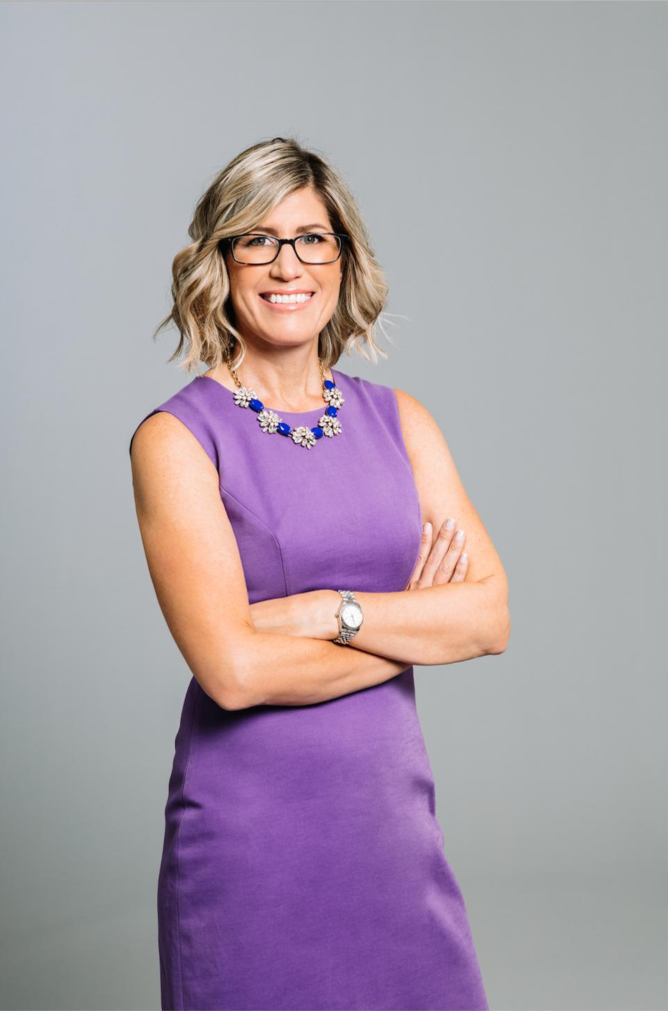 Portrait of Joor CEO Kristin Savilia in a purple dress