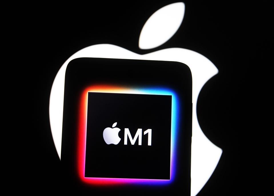 In this photo illustration the Apple M1 chip computer logo...