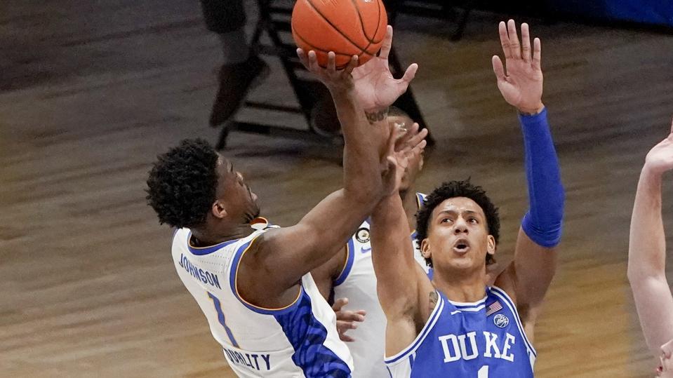 Pittsburgh's Xavier Johnson, left, shoots over Duke's Jalen Johnson.
