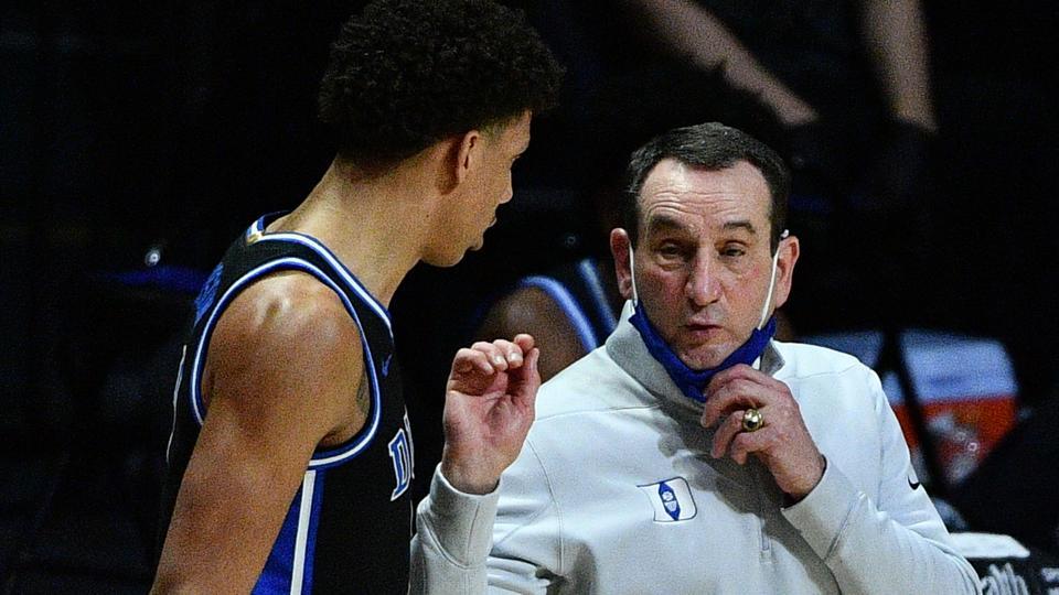 Head Coach Mike Krzyzewski of the Duke Blue Devils speaks with Jalen Johnson.