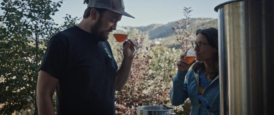 Christoph Bichler (Bierol) and Julia Herz (Brewers Association) taste the wort while homebrewing on Julia's terrace in Lyons, Colorado