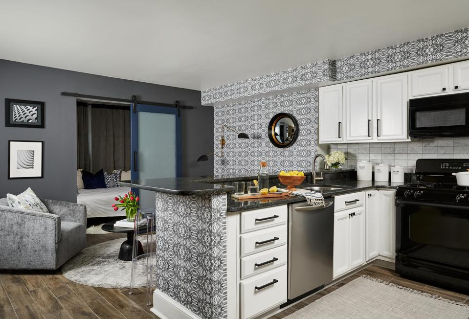 A beautiful kitchen and living space with vibrant wallpaper.