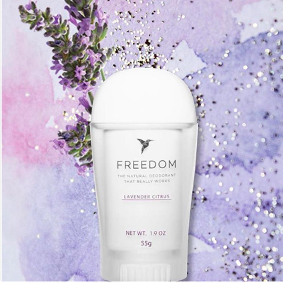 A tube of Freedom deodorant against a purple background