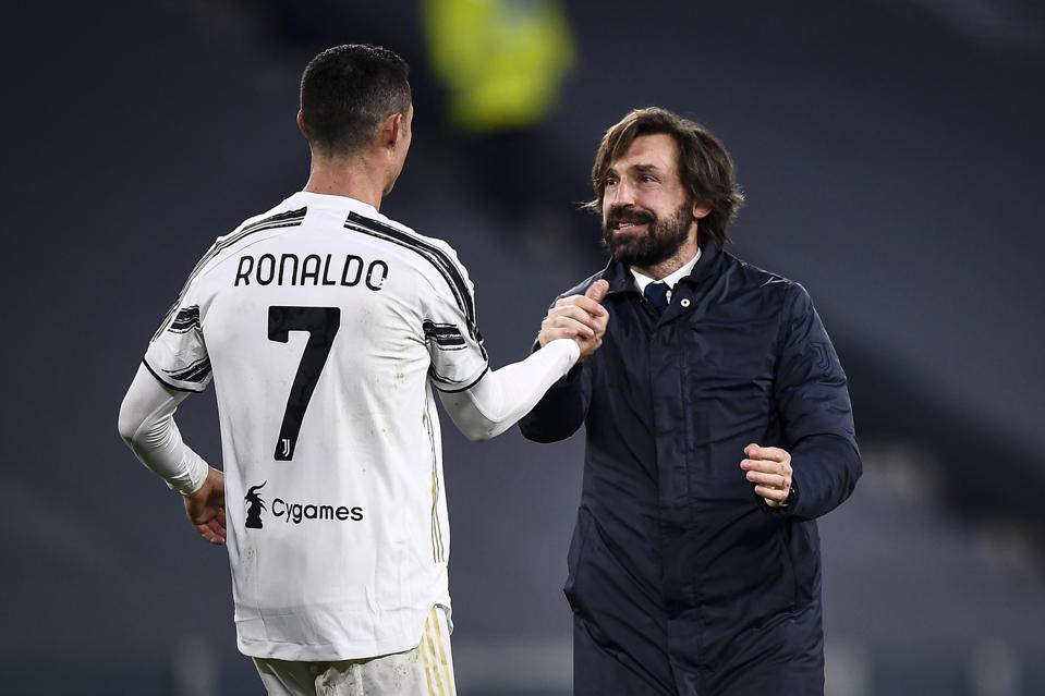 Cristiano Ronaldo (L) of Juventus FC shakes hands with...