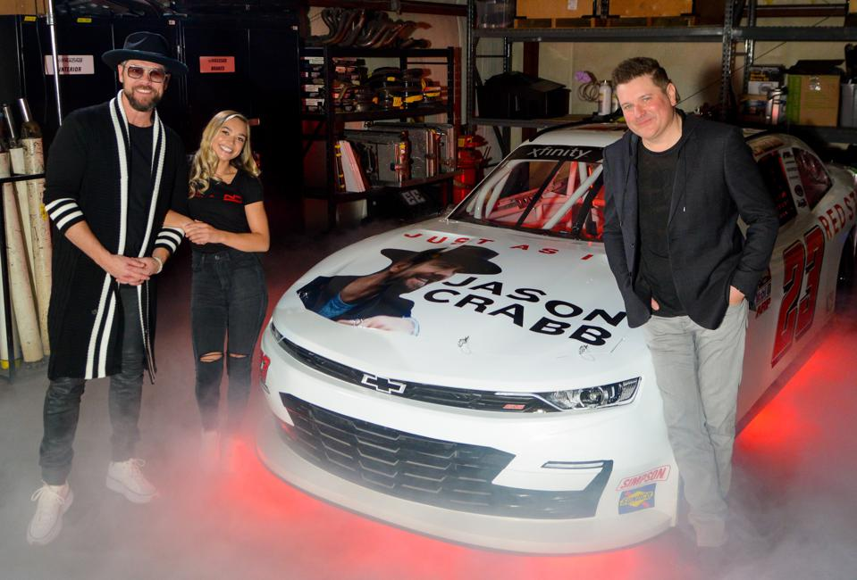 Natalie Decker with performing artist Jason Crabb (left) and Red Street Records co-owner JayDeMarcus.