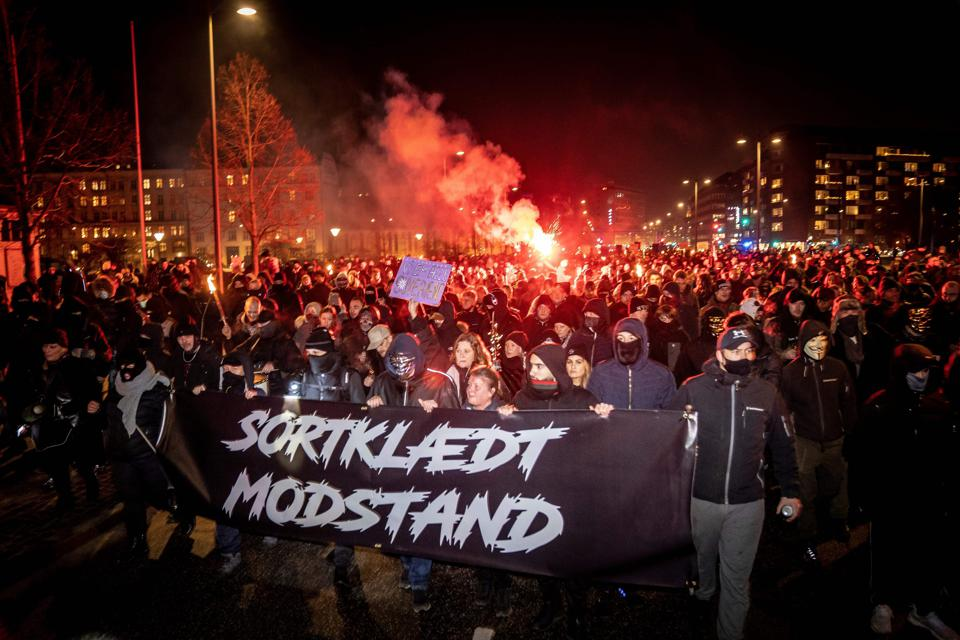 Demonstrators march against Covid-19 restrictions introduced by the Danish government in Copenhagen on January 23, 2021.