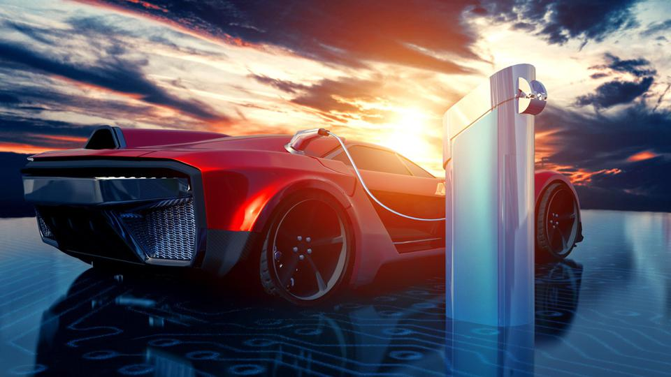 Electric sports car gets charged with solar power outside as the sun sets